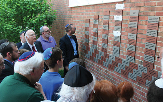 At the Wall of Community dedication are TBEMC leaders, from left, choir director Spencer Brooks, then interim Rabbi David Klatzker, immediate past president Elliot Ballen, and new religious leader, Rabbi Neil Tow.