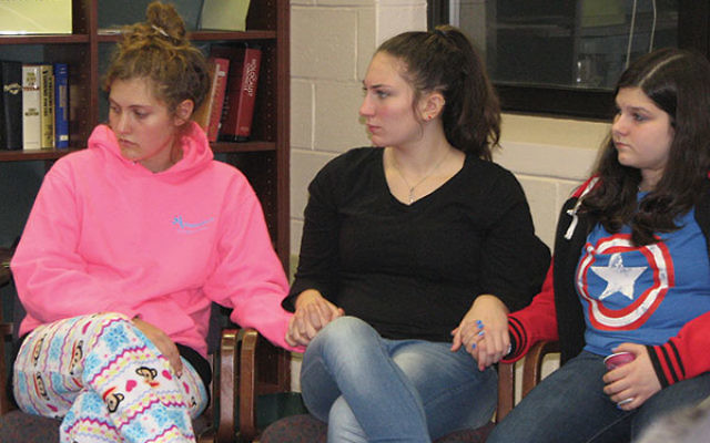 High school students, including, from left, Sophie Plaut, Sadie Link, and Mollie Miller, shared their reactions to the election in an emotional discussion led by Rabbi Steven Kushner at Temple Ner Tamid.