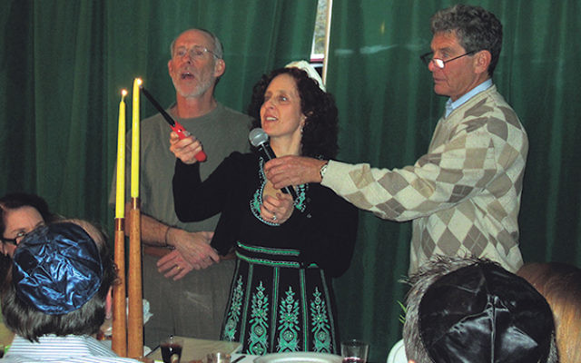 The Tepman family meets at the Gillenwater home in Warren in 2013 for their annual seder, now reaching its 110th year.