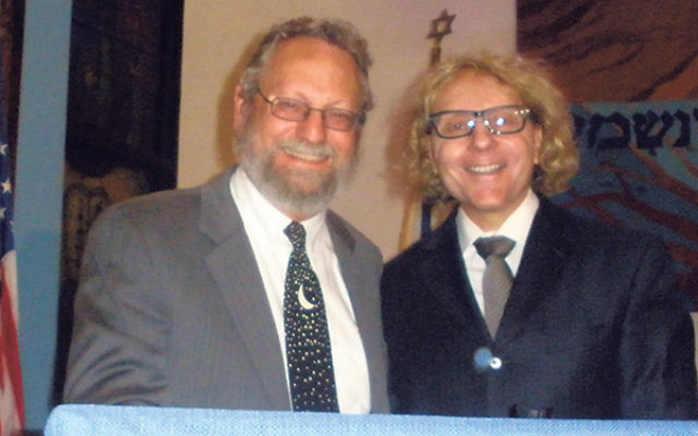 Thane Rosenbaum, right, spoke about the rise of anti-Semitism and the growing threat of Muslim extremism; with him is Congregation B'nai Tikvah's Rabbi Robert Wolkoff.