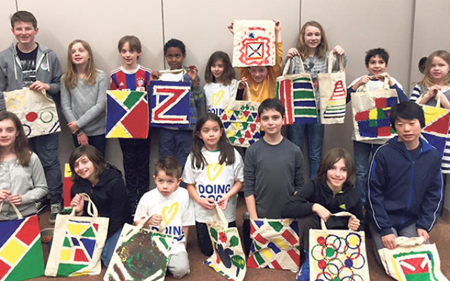 Tikkun Olam Tour participants display the bags they painted for Leket, Israel's largest food bank.