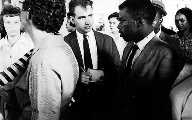Writer Calvin Trillin, center, interviewing John Lewis in Birmingham, Ala., as the Freedom Riders were boarding the bus for Montgomery in 1961.