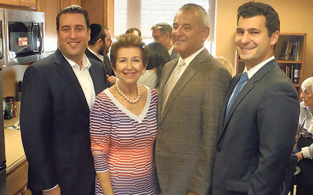 Danny and Claire Kahane, center, are joined by their son-in-law Richard Pomerantz, left, and their son Jason at the dedication of the new Bikur Cholim Room at Trinitas, which they funded in honor of their respective parents.