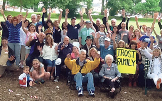 A big hurrah from four generations of the Trost family — 59 members in all — gathered for a reunion picnic on June 21 in Warinanco Park. Matriarch Ann German is seated in front, to the left of the sign.