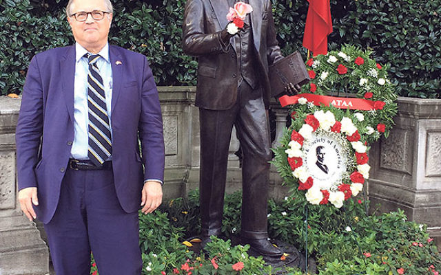 Dr. Mark Meirowitz by the statue of Mustafa Kemal Ataturk, the founder of the Turkish Republic, next to the Turkish Embassy in Washington, DC.