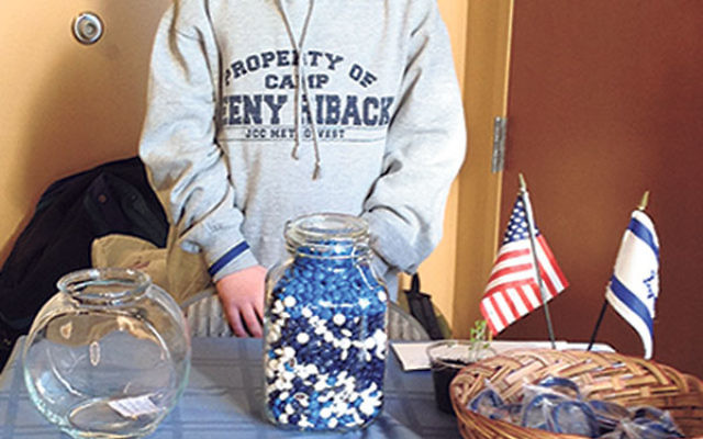 Benjamin Pincus held an M&Ms guessing contest at Temple Shalom to raise funds for FIDF.