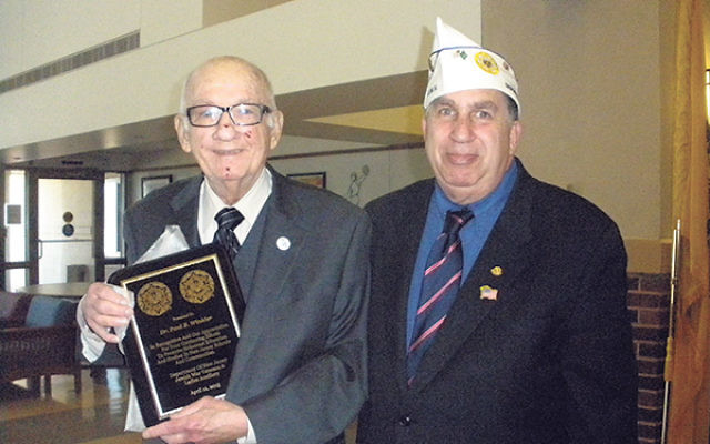 Senior vice commander Al Adler, right, presents a certificate of appreciation to NJ Commission on Holocaust Education executive director Dr. Paul Winkler on behalf of the New Jersey JWV and Ladies Auxiliary.