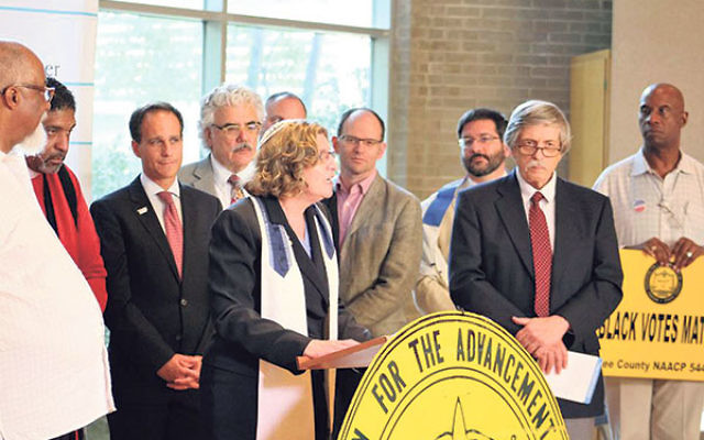 Rabbi Joel Abraham, third from right, takes part in a press conference about the Nitzavim campaign in Raleigh, NC, with other rabbis and state NAACP leaders.