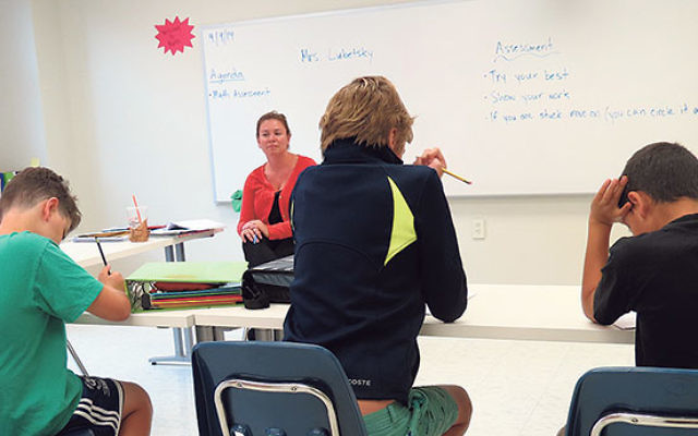 Renee Lubetsky teaches a math class to newly enrolled students at Winston Prep.