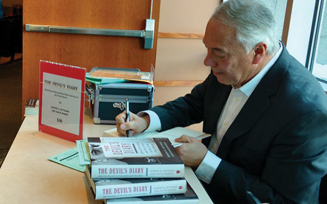 "Robert Wittman signs copies of his book detailing his search and recovery of the diary of Alfred Rosenberg, a leading architect of the Third Reich who ""in some respects turned Hitler into Hitler."""