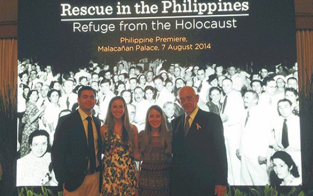 Dick Frieder, far right, and his grandchildren, from left, Steven Wilf, Lizzie Frieder, and Laura Conn, at the premiere of Rescue in the Philippines at Malacanang Palace in Manila.