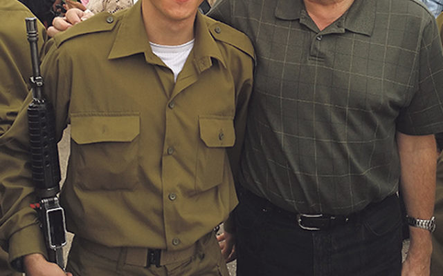 Hirsch Alter, left, who grew up at EBJC, became a member of the IDF in November. Through Yashar LaChayal, the synagogue plans to donate rain gear and water backpacks to all 125 soldiers in his unit.