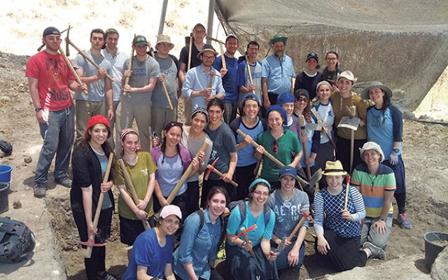 Aviva Cantor, middle row, fifth from right (partially hidden), and Elisheva Elbaz, back row, second from right, geared up with other members of the Bar Ilan University Summer Science Research Program for a dig at the Tell es-Safi archaeological project, n