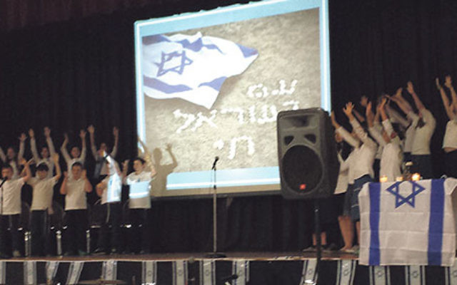 Children from the JEC Yeshiva of Elizabeth choir sing in celebration of Israel at the Union Y.