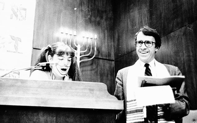 Rabbi Gerald Zelizer conducts Purim services early in his 45-year tenure at Congregation Neve Shalom.