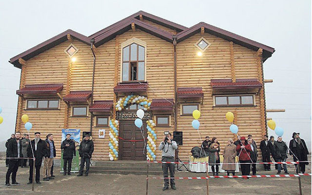 Jewish refugees in Anatevka celebrate the opening of the community's new synagogue, Feb. 29.
