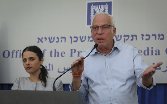 Members of Jewish Home party MK Ayelet Shaked (L), Minister of Housing and Construction Uri Ariel (R) speak with the press after a meeting with Israeli President Reuven Rivlin at the president's house in Jerusalem, March 22, 2015 (Hadas Parush/FLASH90