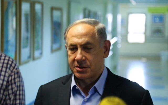 Israeli Prime Minister Benjamin Netanyahu visiting the hospitalized family of a West Bank Palestinian baby killed in an arson attack, July 31, 2015.