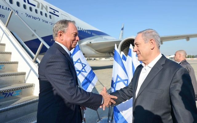 Former New York Mayor Michael Bloomberg, left, is greeted by Israeli Prime Minister Benjamin Netanyahu upon arriving at Ben Gurion International Airport near Tel Aviv on July 23, 2014, a day when many foreign carriers still had flight bans to Tel Aviv. (H