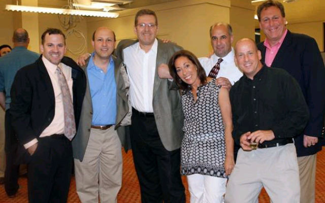The JCC of Central NJ building committee gathered at the June 9 annual meeting, from left, executive director Barak Hermann, Steve Needle, Jeff Silverstein, Lesley Black-Vogel, Idan Levin, Mitch Harris, and Peter Weissbrod. Photo courtesy JCC of Central