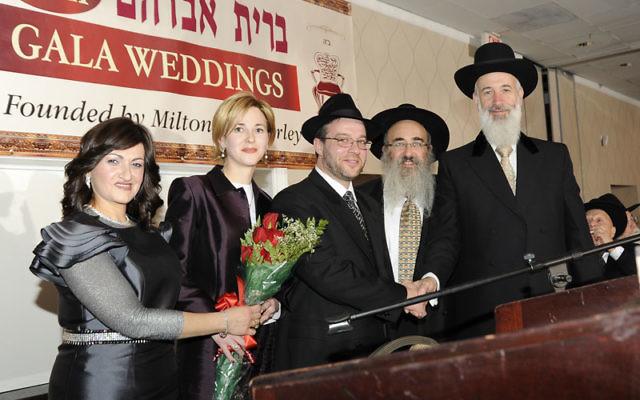 Chief Rabbi of Israel Yona Metzger, right, at Bris Avrohom's 25th annual wedding gala with, from left, Shterney Kanelsky, Nehama and Pinchas Shutyak, and Rabbi Mordechai Kanelsky. Photos courtesy Bris Avrohom