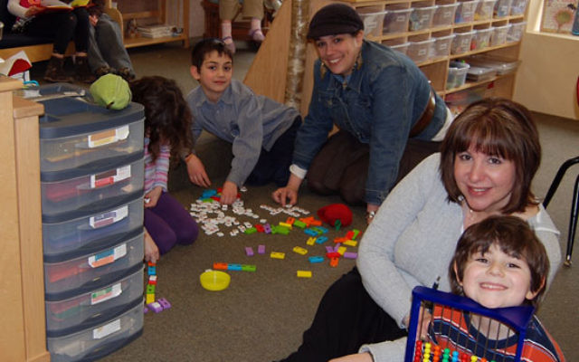 Malkie Herson, center, educational director of the Chabad Jewish Center in Basking Ridge, and teacher Melissa Yarger play word games with kindergarten students. Photo by Elaine Durbach