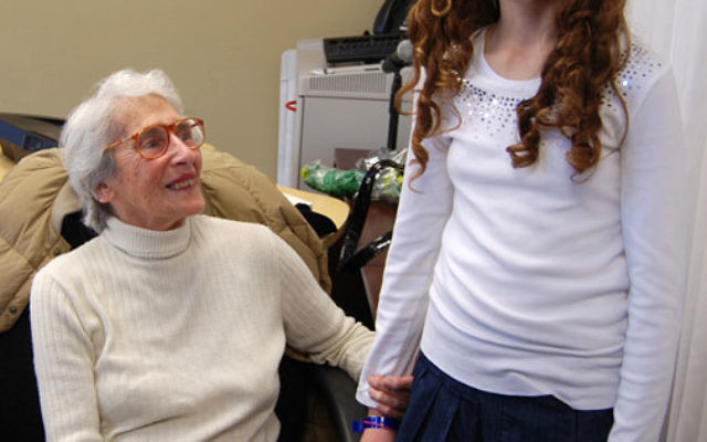 Survivor Anitta Fox talks with JEC fifth-grader Ava Weiss at the Cafe Europa Hanukka party. Photos by Elaine Durbach
