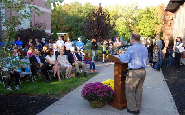 JCC executive director Barak Hermann thanked the Wilf family, seated in the front row, and members of the community for making possible the $1 million renovation. Photos by Elaine Durbach