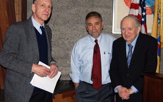 During a break in his Kean University seminar on the Holocaust, Michael Berenbaum, center, talks with Dr. Keith Nunes, and Dr. Joseph Preil. Photo by Elaine Durbach