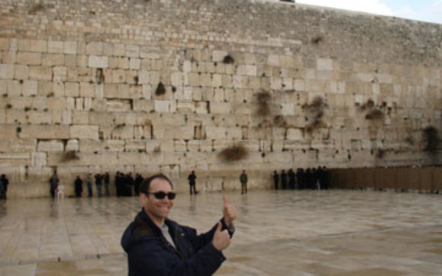 Giving Israel the thumbs up, recent immigrant from New Jersey Gil Margulis gives his vote of approval to the Kotel…