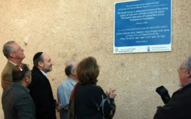 Jewish Federation of Central New Jersey leaders attend the unveiling of a plaque at the Young Adult Center in Arad last winter, financed by a grant from the Ness Fund.