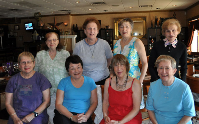Shelly Freedman, front row, right, meets with members of Women on Their Own, from left, front row, Marge Cohen, Rita Ferraro, and Neshama Siner, and, back row, Barbara Rosen, Anita Lepelstat, Lynda Goldschein, and Ann Lubin.