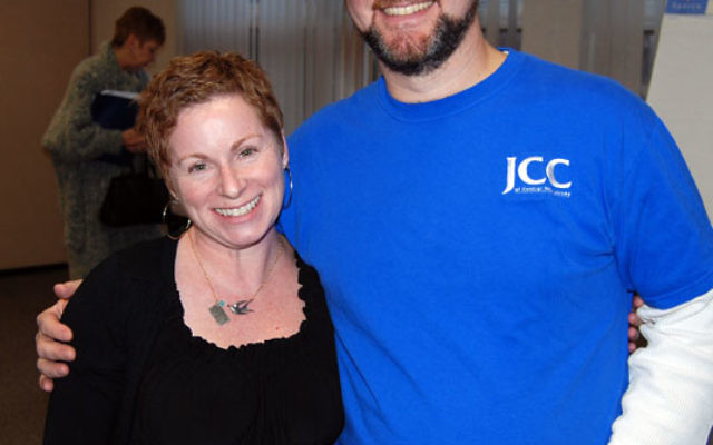 At the JCC's special-needs symposium, program director Mike Goldstein welcomed Sheri-Rose Rubin, who showed a video about her son's preschool experience.
