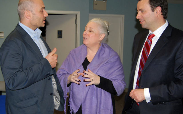 JDC representatives Gideon Herscher, left, and Dov Ben-Shimon discuss recovery efforts in Haiti with Central federation board member Marcy Lazar. Photo by Elaine Durbach