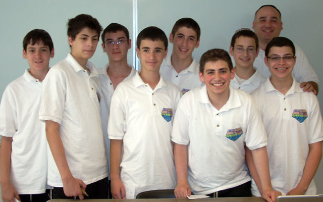 A team of students at the Rav Teitz Mesivta Academy, led by mentor Ken Dietz, rear right, have won a place in the final round of the Gildor Project science competition in Israel. Photo courtesy JEC