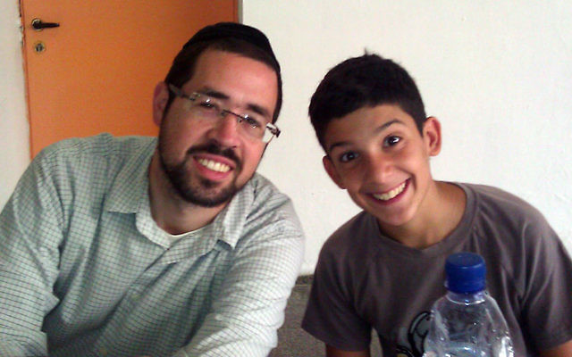 Rabbi Joshua Hess of Linden with a young Israeli at the Counterpoint summer camp in Arad.