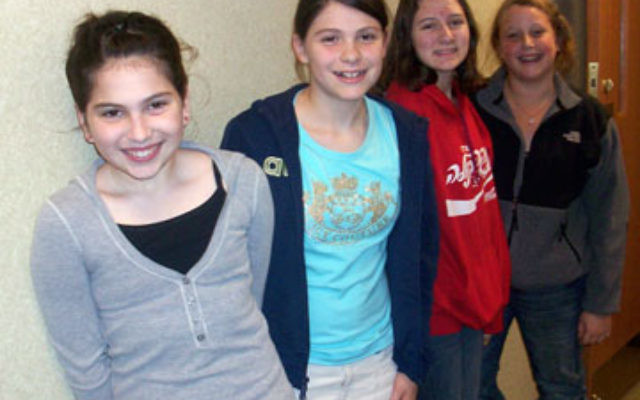 "Inspired by a recent talk by mitzva ""guru"" Danny Siegel, these girls from Congregation Beth Israel — from left, Sarah Barash, Rachel Voetzel, Janna Rosengarten, and Rayna Geller — have undertaken an array of tzedaka projec"