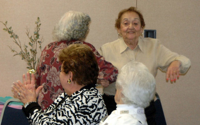 Lauran Newell, rear left, and Rose Handler dance to the music of Odessa Klezmer, watched by Helen Forman, front left, and Florence Hagman at a brunch held as part of the JCC's ongoing adult enrichment program. Photo courtesy JCC of Central NJ
