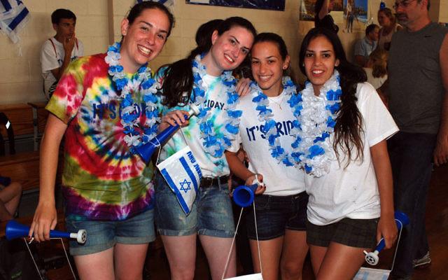 Israeli shlihot, from left, Dana Goldkorn, Itan Halfin, Hila Ehrenlieb, and Shira Yehuda are working at the JCC. Photo by Jeremy Enda