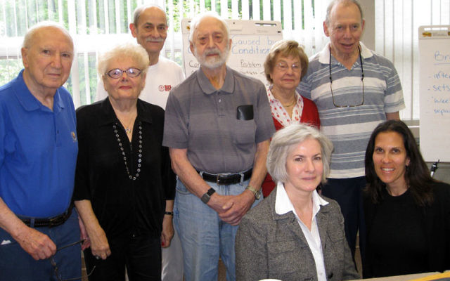 Trainers Lois Dyer and Hedy Knapp, front, left and right, worked with JCC seniors, from left, Dr. Sy Geller, Anny Strauss, Dr. Bertram Warren, Abe Myerson, Eleanor Bouer, and Ralph Dobriner, showing them ways to manage chronic illness.