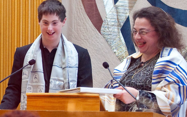 Special education teacher Debbie Linder helped Sam Frankel, who has Down's Syndrome, read from the Torah at his bar mitzva ceremony.
