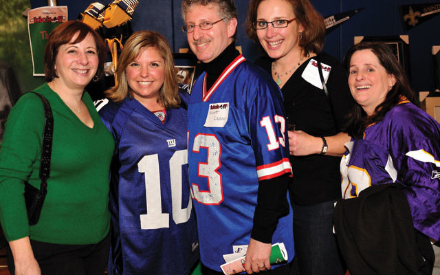 """Launching the JCC renovation capital campaign at its """"Kick Off"""" fund-raiser are JCC president Scott Lazar, center, with, from left, vice presidents Suzanne Tucker and Stacie Friedman, past president Mindy Goldberger, and treasurer Shari Hartst"""