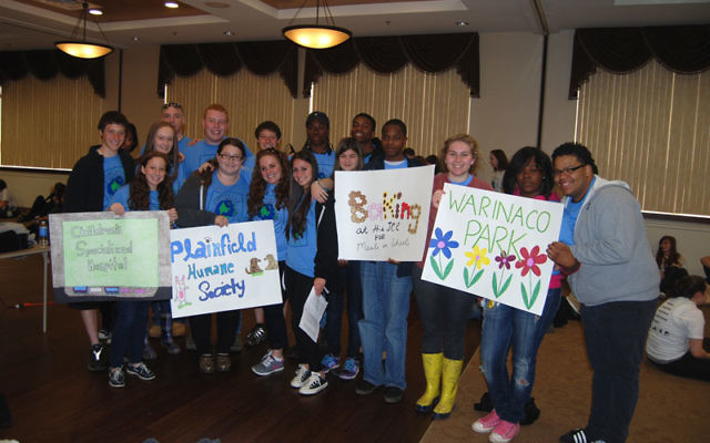 """A committee of teens from the JCC and the """"I Have a Dream"""" Plainfield Project organized their third annual Day of Service on April 17, together with their supervisors Larry Johnson, rear, left, and Mallory Saks, front row, fourth from left. Ph"""