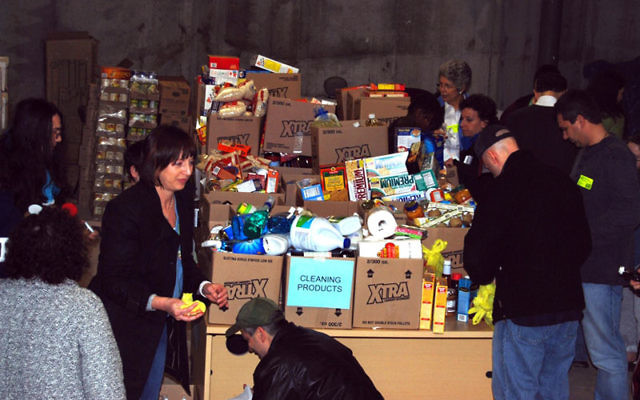 Volunteers shopped for stacks of groceries and then deposited them in the basement at the JFS headquarters in Elizabeth.
