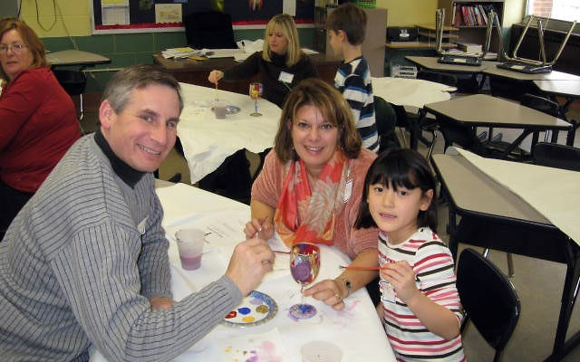 At a recent Temple Sholom family education program, Larry Trenk, Jill Kaplan, and MacKenzie Trenk explore their creativity.