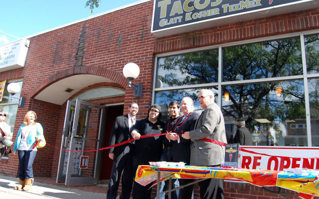 At the opening of the Elizabeth's new kosher taco restaurant, Mayor Chris Bollwage cuts the ribbon, accompanied by, from left, Rabbi Joshua Hess, owners Eli Barashi and Josh Weiss, and Gordon Haas. Photos by Elaine Durbach