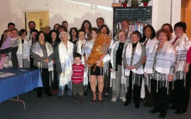 Women as well as men wore tallitot at the Shabbat service at Temple Sholom on Dec. 18, to show solidarity with the Jerusalem group Women of the Wall.