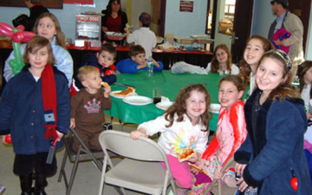 Young fair-goers at last year's Union Y Jewish Fair and Expo gather for some Israeli-style noshing.