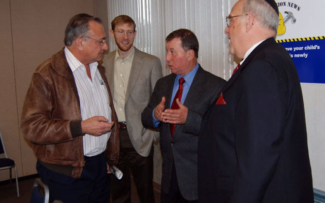 Ariel Mayor Ron Nachman, second from right, talks with, from left, Arnold Lidsky, Avie Zimmerman, and Gordon Haas.