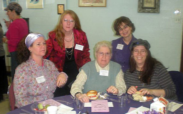 The Queen Esther Tea at the Union Y drew around 80 women, including, from left, front row, Sue Shapiro, Roberta Einhorn and her daughter, Charla Schnipper, and, back row, Shari Bates and Anita Kolat.